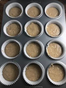 banana muffin mixture in muffin cases in a muffin tray
