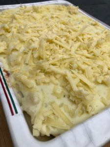 beef lasagna in a dish ready for the oven