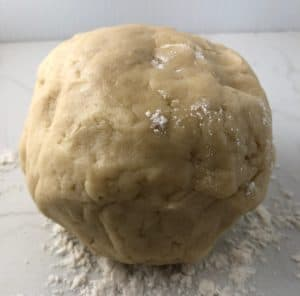 Pastry ball on floured surface