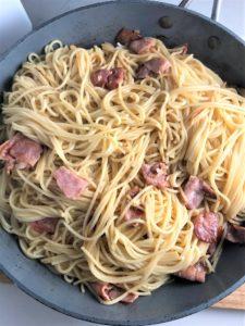 spaghetti carbonara in a frying pan