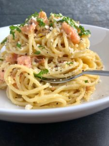 spaghetti carbonara with smoked salmon parsley parmesan in bowl