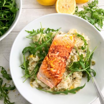 pan fried salmon fillet over a lemony risotto sprinkled with rocket leaves and lemon zest