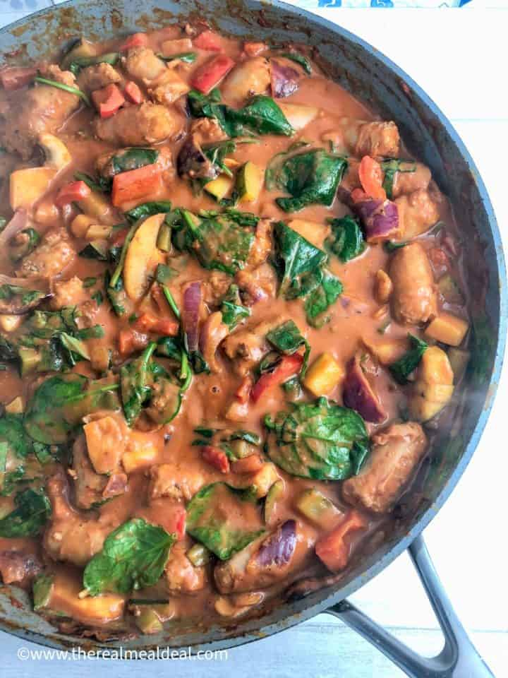 sausage onion pepper courgette mushrooms passata wilted spinach in pan