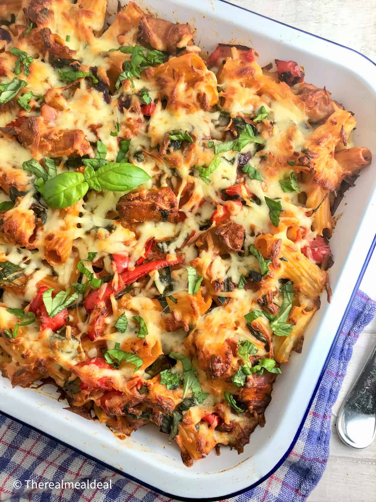 Sausage Pasta Bake cooked in tray topped with fresh basil