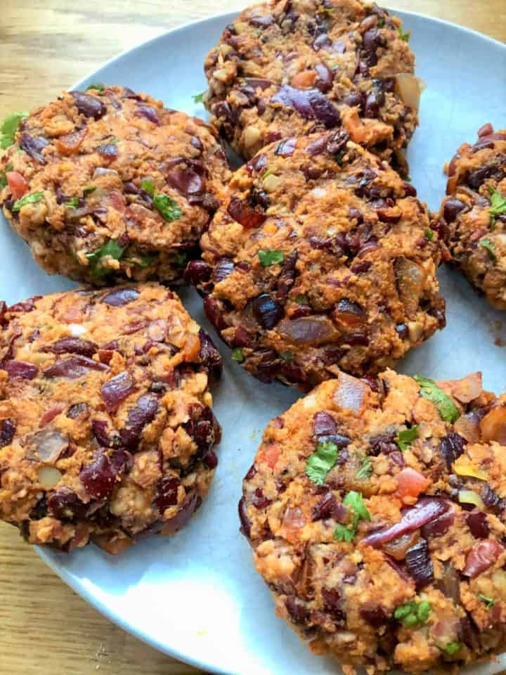 uncooked spicy bean burgers on plate