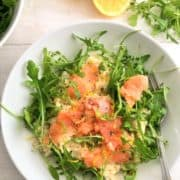smoked salmon risotto topped with rocket leaves and lemon zest